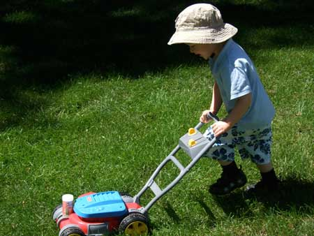 Boy-Mowing-Grass